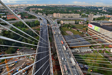 St-Petersburg, Russia -  August 31, 2007: View from the pylon cable-stayed bridge at road junctions, motor transportation streams, and the city in northern Europe, summer, daytime. Editorial Use Only.