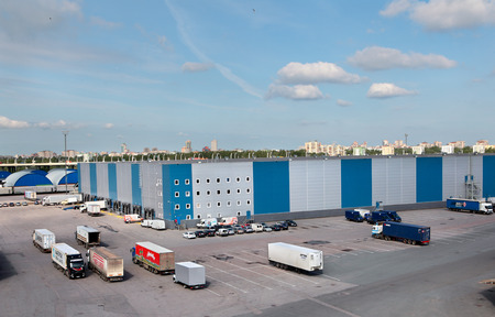 St. Petersburg, Russia - june 13, 2013: Warehouse logistics complex with loading and unloading docks, parking space trailer trucks, warehouse buildings. Editorial Use Only.