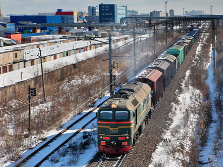 goods train: Goods train carries cargo along the track, in the industrial area.