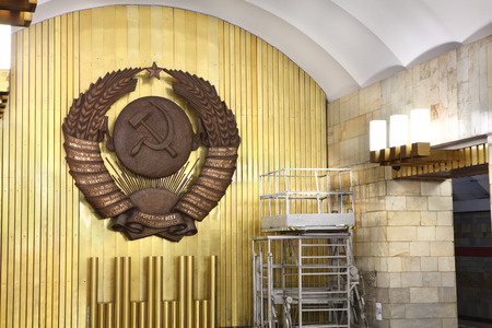 St. Petersburg, Russia - March 7, 2014: Coat of arms a Soviet Union in interior subway station. Emblem a USSR in interior decoration metro station.