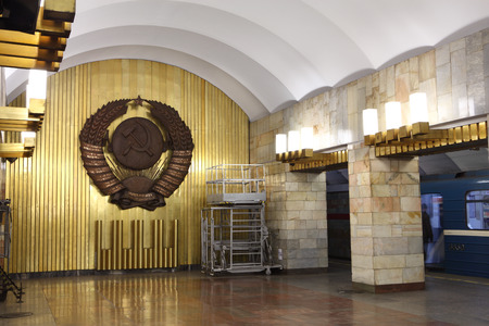 St. Petersburg, Russia - March 7, 2014: Emblem a Soviet Union in interior decoration metro station. Coat of arms a USSR in interior subway station.