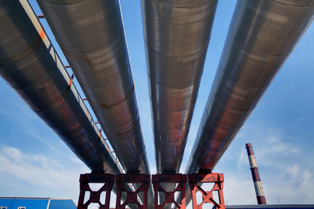 Steel pipes, pipe bridge, overground lines, open heating pipeline. photo
