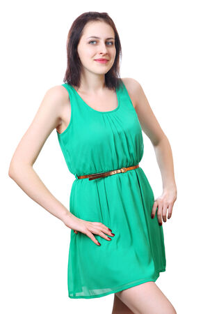 One person, a young Caucasian woman, 18 years old in a short green sleeveless dress, standing vertical portrait, isolated image on white background. Stock Photo