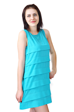 18 years old: One young woman 18 years old, in a light blue, short, summer dress without sleeves, girl standing smiling, vertical portrait, isolated on white background.