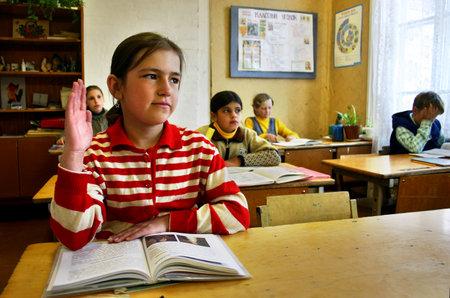 raise your hand: Tver, Russia - May 2, 2006: Schegoleva Tanya, 11 years old, Rural school, school class, schoolgirl raises his hand.