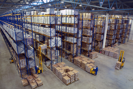warehouse: St. Petersburg, Russia - November 21, 2008: Interior warehouse storage, vertical storage, pallets on shelves overhead racks, interior large warehouse with freight stacked high.