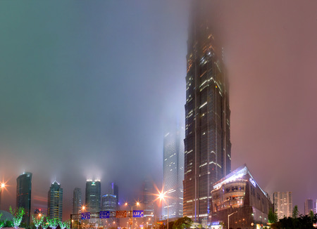 jin mao tower: Shanghai, China - April 20, 2010: Jin Mao Tower, Pudong New Area, nighttime, dense fog