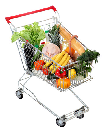 filled shopping trolley, grocery trolley filled with food photo