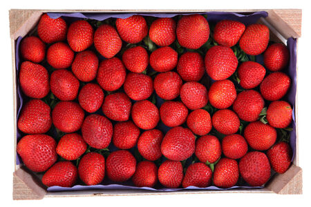 perishable: Perishable food, a wooden pallet with red fruits strawberries, isolated image on white background.