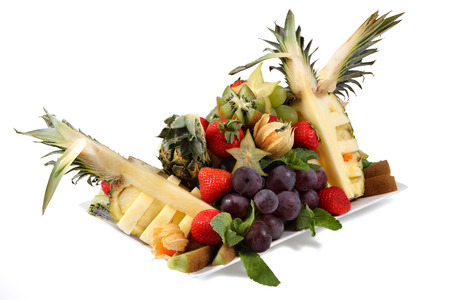 Fruit Mix, a set of exotic fruits, fruit assortment on a white plate, isolated on a white background. Pineapple, strawberries, grapes, kiwi. photo
