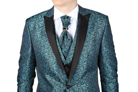 Fashionable mens suit with a blue-green floral pattern, designed for a wedding or prom, isolated on white background. Stock Photo