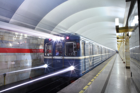 electric avenue: St. Petersburg, Russia - March 7, 2014: Subway station Grazhdanskiy prospekt, underground urban public passenger transport. Electric train with blue carriages departs from the subway station platform. Editorial