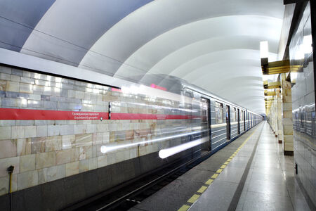 electric avenue: Saint Petersburg, Russia - March 7, 2014: Subway station Grazhdanskiy prospekt, urban public passenger transport. Blue Train departs from subway station platform. Civic avenue,  underground metro station. Editorial