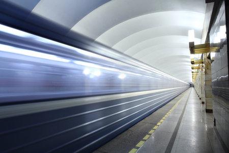 subway platform: Saint Petersburg, Russia - March 7, 2014: Subway station Grazhdanskiy prospekt, urban public passenger transport. Public passenger transport, metro station,  train departs from subway platform.