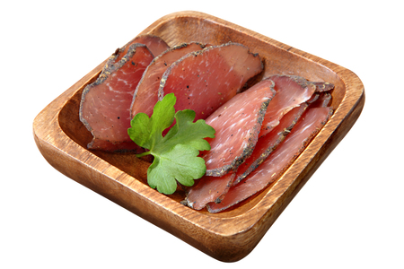 piggish: Jamon cured pork meat sliced on wooden bowl,  isolated on white background.