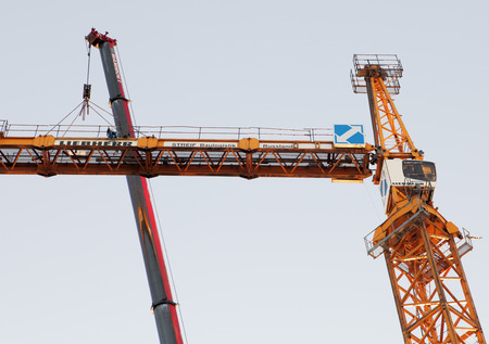 jib: St. Petersburg, Russia - October 29, 2014:  Setting Up A Tower Crane. Installation work on mounting section of the tower crane. The Counter Jib Is Installed.
