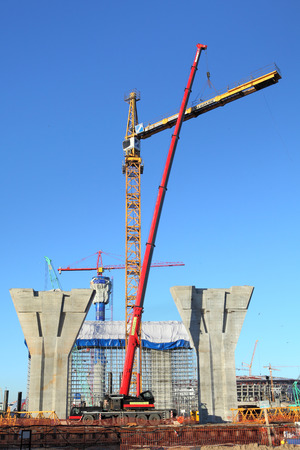 jib: St. Petersburg, Russia - October 29, 2014:  Setting Up A Tower Crane In The Construction Site. The Counter Jib Is Installed.