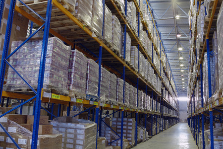 St. Petersburg, Russia - November 21, 2008: Narrow passageway goods warehouse with pallet storage system, shelves shelves.