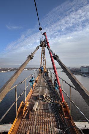 jib: St. Petersburg, Russia - October 30, 2014: Assembling tower crane, high-altitude installation works,  Setting tower crane, high-altitude erection works, tower peak, apex, jib tie bars,  construction. Editorial