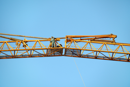 jib: St. Petersburg, Russia - October 30, 2014: Mounting works on the connection of the Hoisting Jib sections of the tower crane.