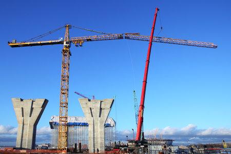 jib: St. Petersburg, Russia - October 30, 2014: installing jib tower crane, Connecting outer jib to inner jib, Installation of a construction crane at a construction site. Editorial