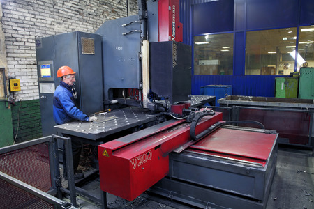 St. Petersburg, Russia - October 10, 2014: Plant for the production of metal structures, work the operator controls the drilling machine.  Metal processing machines.