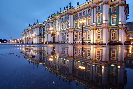hermitage: St. Petersburg, Russia - The building of the Winter Palace, which houses the Hermitage Museum at night illumination, reflected in the water paving puddle. Editorial
