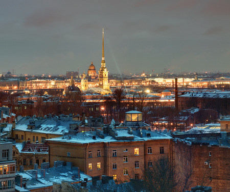 Russia, Saint Petersburg top view of the city in the evening light in the winter, the building of a residential area on the background of the spire of Peter and Paul Fortress.