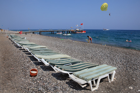 deck chairs: Kemer, Turkey - August 29,  2014: Deck chairs on the pebble beach of the Mediterranean resort. Editorial