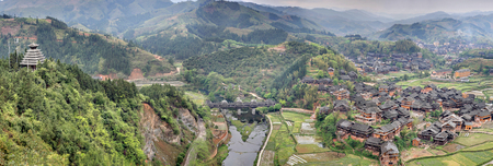tourist attractions: Sanjiang, Guangxi Province, China - April 6, 2010:  Chengyang Wind and Rain Bridge, Wooden bridge Chengyang Dong Villages, tourist attractions in the vicinity Sanjiang, countryside in mountain area.