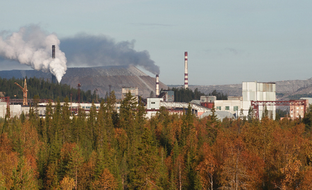 slag: Kovdor, Murmansk region, Russia - September 3, 2007: Mining and Processing Plant,  Industrial complex of the Murmansk region ore extraction, slag heaps mine, smoke a pipe factory. Editorial