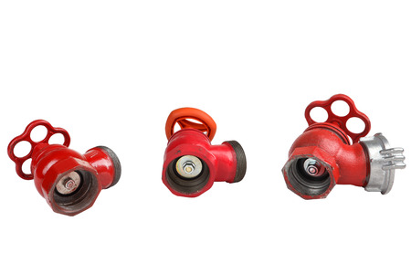 castings: Set of three red, cast-iron fire valve to regulate the water pressure in the fire hose, an external thread for the connection of a fire hose, fire hydrants for location indoors, isolated on white. Stock Photo