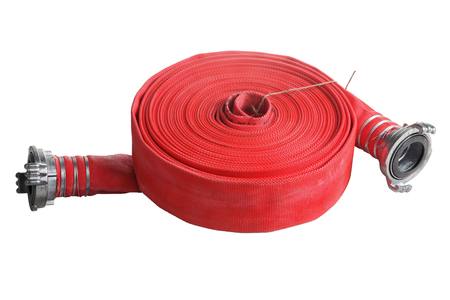 hosepipe: Rolled into a roll, red fire hose with aluminum connective couplings, Isolated on white background. Stock Photo
