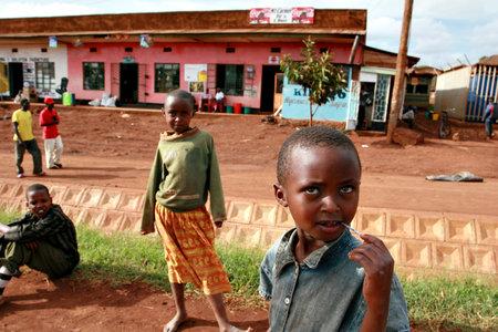 waif: Makuyuni, Arusha, Tanzania - February 13, 2008: Dark-skinned African street children play in the village street. Editorial