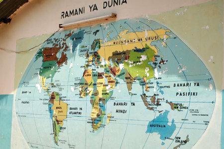 Dar es Salaam, Tanzania - February 21, 2008: World map that hangs on the wall at the entrance to the school yard, Ramani ya Dunia, World Map in Swahili Redakční