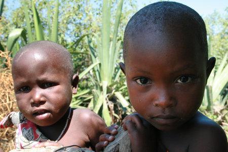 approximate: Meserani Snake Park, Arusha, Tanzania - February 14, 2008: Unidentified African black children Maasai, the approximate age of 3-5 years, closeup portrait.