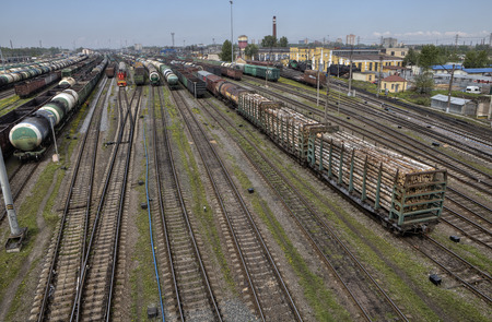 boxcar train: St. Petersburg, Russia - May 22, 2015:  Cargo car are stored awaiting departure as a new train, those strings are assembled on the tracks of the classification yard.