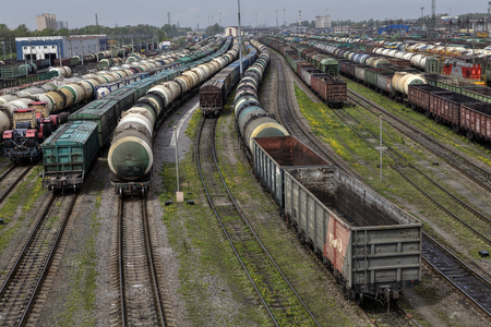 classification: St. Petersburg, Russia - May 22, 2015: Oil tank and trains on railroad tracks, classification yard, industrial view with lot of freight railway trains waggons.