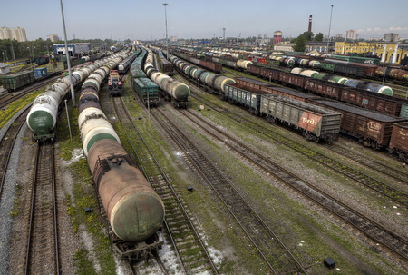 classification: St. Petersburg, Russia - May 22, 2015: Classification yard, Freight Station with trains, freight train leaves railroad shunting yard, Parked freight trains.