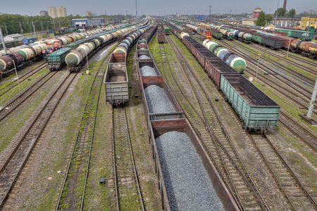 goods train: St. Petersburg, Russia - May 22, 2015: Classification yard, many railway track lines, railroad freight yard, goods train with bulk cargo, logistics park.