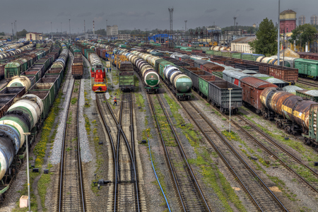 awaiting: St. Petersburg, Russia - May 22, 2015: Railroad Freight Yard, Many freight cars are lined up in huge classification yard, are stored awaiting departure as a new train.