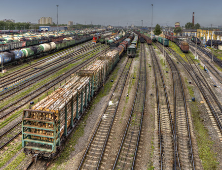 wood railroads: St. Petersburg, Russia - May 22, 2015: Freight trains ready to depart for shunting yard. Many wagons and railway tracks on the big freight station Russian Railways.