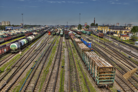 goods train: St. Petersburg, Russia - May 22, 2015: Ready for delivery freight wagons to Classification yard of Russian Railways, marshalling yard in Russia, goods transport freight trains.