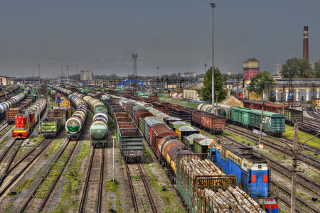 goods train: St. Petersburg, Russia - May 22, 2015: Railway station marshalling yard Moscow, classification yard, rail tracks colour,  proviso departure, freight train ready for departure. Editorial