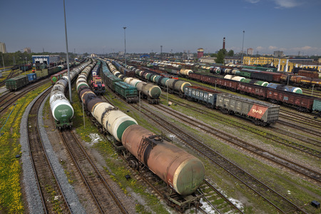 goods train: St. Petersburg, Russia - May 22, 2015: big railway cargo station junction with lot of trains and track lines, Freight Station with trains, Freight train pulling several box and tank cars on summer day