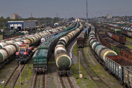 freight train: St. Petersburg, Russia - May 22, 2015: Freight train station, marshalling yard, railway track, rail freight transport, city cargo terminal,  shunting wagons, train cargo service.
