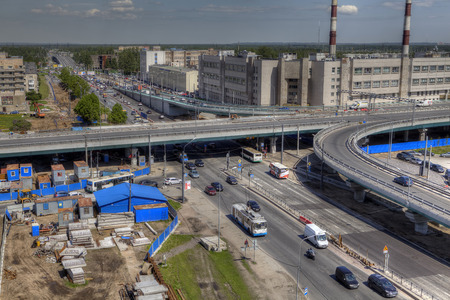 conjunction: St. Petersburg, Russia - May 29, 2015: Top view of the unfinished road interchange at the intersection of Avenue Piskaryovsky, with the Nepokarennyh Avenue.
