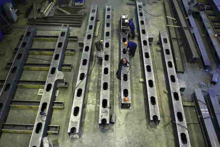 steel building: St. Petersburg, Russia - May 18, 2015: Structural steel fabrication process, steel construction, manufacturing building beams at a metal factory.