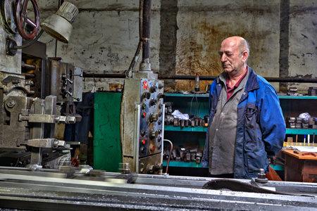 machine operator: St. Petersburg, Russia - May 21, 2015: Horizontal milling and boring machine planing, working machine operator controls the processing of metal.