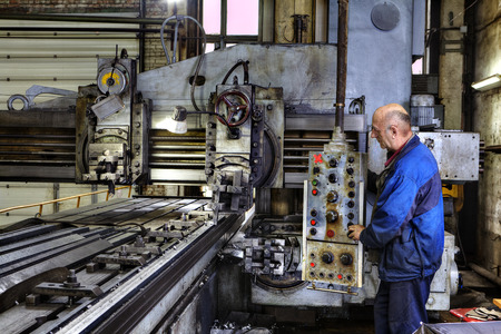 St. Petersburg, Russia - May 21, 2015: Machine tool operator planing and milling double column. Editorial